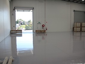 A thin-film rollcoat system on a warehouse floor.
