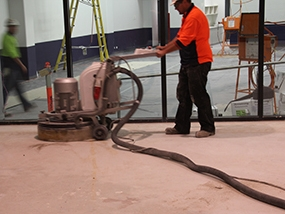 A contractor conducting surface preparation with a diamond grinder.