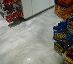 Metallic epoxy floor in a candy store.